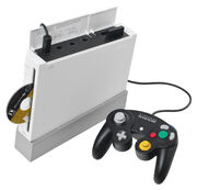 Wii console with black GameCube controller
