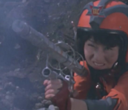 Mikawa with gun