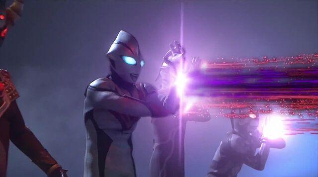 File:Evil Shot vs Tiga's attack.jpg
