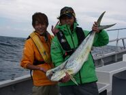 Takeshi & Taiyo with a fish