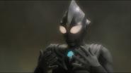 Daigo shocks when he appears as Tiga Dark