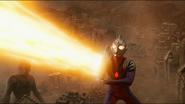 Ultraman Tiga fires Zepellion Ray