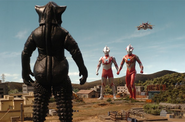 Mefilas faces Ultraman, Mebius, and GUYS