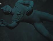 Tiga's statue sinking in the sea