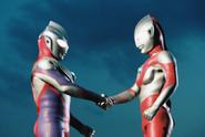 Tiga ultraman hand shake