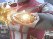 Mebius charges the Mebium Shoot