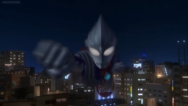File:Tiga flies and punches.png