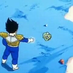 Vegeta mercilessly slaughters what remains of Guldo's head