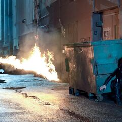 Selene evades a flamethrower.