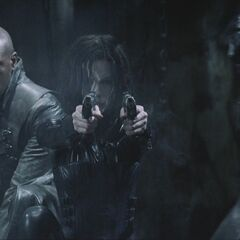 Selene as she fires at Lycans.