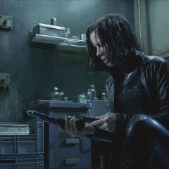 Selene loads her gun.