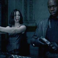 Selene with Kahn in the shooting range.