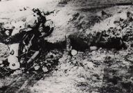 Destroyed German motorcycle and burned corpse of fallen German motorcyclist