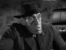 Face shot of Rondo Hatton, balding and with an abnormally sized jaw.