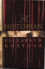 """Dark brown book cover saying """"The HISTORIAN""""; then """"A Novel"""" in a shiny gold stripe, then """"ELIZABETH KOSTOVA"""". A few thin reddish streaks stretch from the top almost to the bottom."""