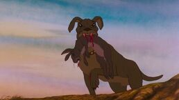 Watership Down Dog holding dead rabbit