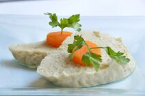 1024px-Gefilte fish topped with slices of carrot