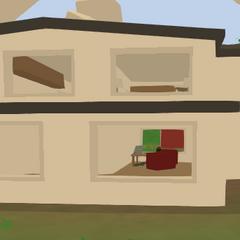 Casa de la granja vista por detrás