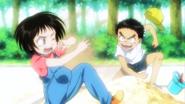 Young Ushio throwing sand at Asako