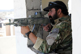 800px-Afghan border police aiming a weapon