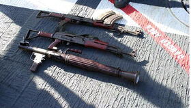 US Navy 060318-N-8623S-001 Confiscated weapons lay on the deck of guided missile cruiser USS Cape St. George (CG 71) following an early-morning engagement with suspected pirates