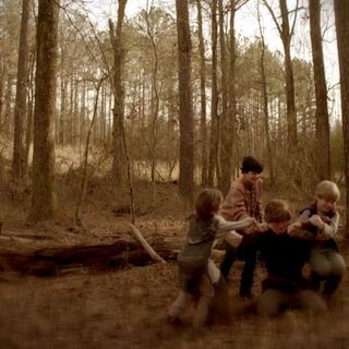 Young Kol and his siblings are seen in flashback having fun together.