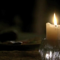 Bonnie after lighting a candle