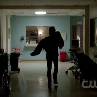 Damon carrying Elena out of hospital
