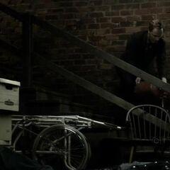 John pouring oil over basement