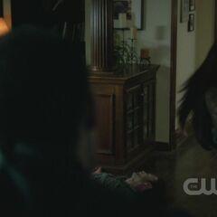 Tony sees Elena run towards Alaric.