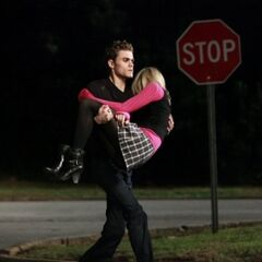 Stefan carrying a knocked out Caroline.