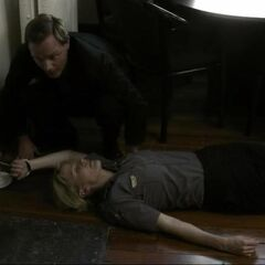 John cuffs Sheriff Forbes after knocking her out