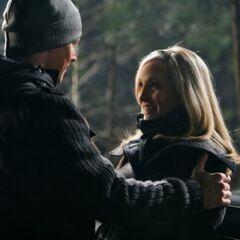 Caroline and Matt in the woods.