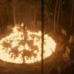 Emily kreiert ein Pentagramm aus Feuer.
