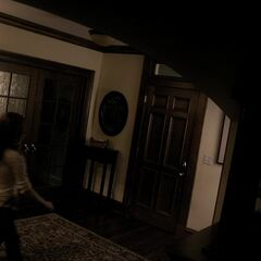 A different shot of the entry hallway – front door on the right, the double door to the ??? room behind Jenna