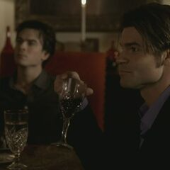 Damon and Elijah at the dinner party