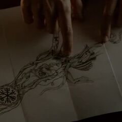 The tattoo reveals a spell to open the tomb, or something like this.