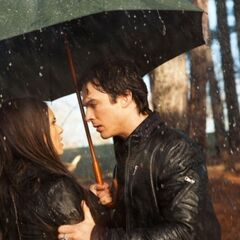 Elena and Damon in the rain.