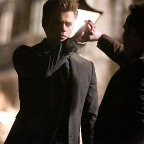 Stefan crushing Duke's hand.