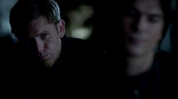 Alaric watches Damon