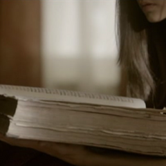 Elena reading the book in a deleted scene
