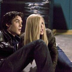 Damon and Rebekah watch in horror as Alaric stakes Klaus