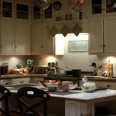 The kitchen island and the stove, you can see both kitchen windows