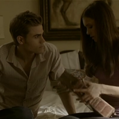 Elena showing Stefan the book in a deleted scene