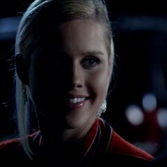 Rebekah wearing Matt's football jacket
