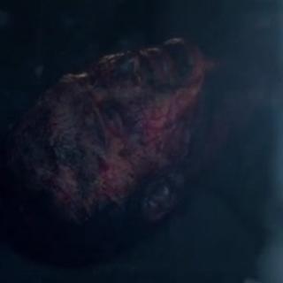 Le corps calciné de Markos dans l'autre côté