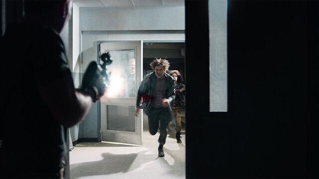 File:Help Me 1x01 Axel shoots vampires.jpg