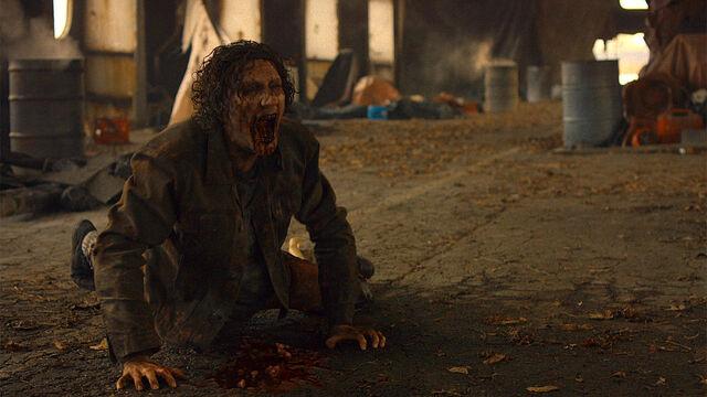 File:Stay Inside 1x03 Feral vampire dies after drinking Vanessa's blood.jpg