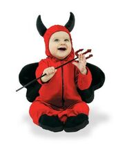 Baby dressed as devil holding trident
