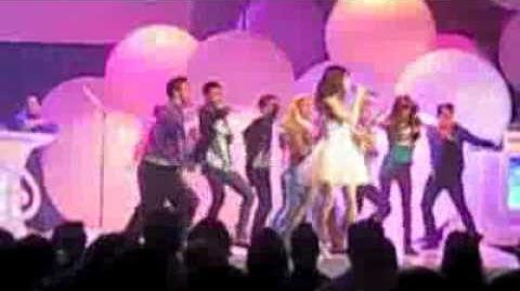 Selena Gomez singing Shake it up with Bella Thorne on stage